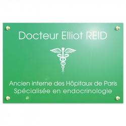 Plaque en plexiglas vert avec texte blanc